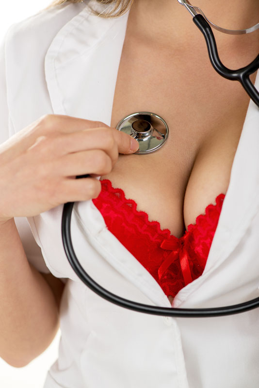 Nurse with stepthoscope on breast